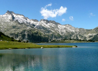 Rent a holiday home in the Hautes-Pyrenees. This picture shows Lac Bleu - a natural lake formed in the mountains at over 1000m above ground level. Totally isolated, the only route there is on foot from Chiroulet. Allow a whole day - It's a 3 hour climb/descent each way!