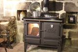 Log burning stove - The ESSE log burning stove is only for use during the cooler months. The house is also equipped with a double electric oven for day-to-day cooking.