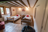 Downstairs bedroom in L'Ecurie with twin beds0