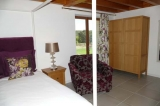 Bedroom one on the groundfloor with French doors leading to the garden