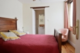 Bedroom - On the groundfloor, double bed, en-suite shower room with toilet and washbasin.