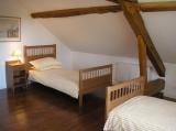 Twin bedroom under the original beams